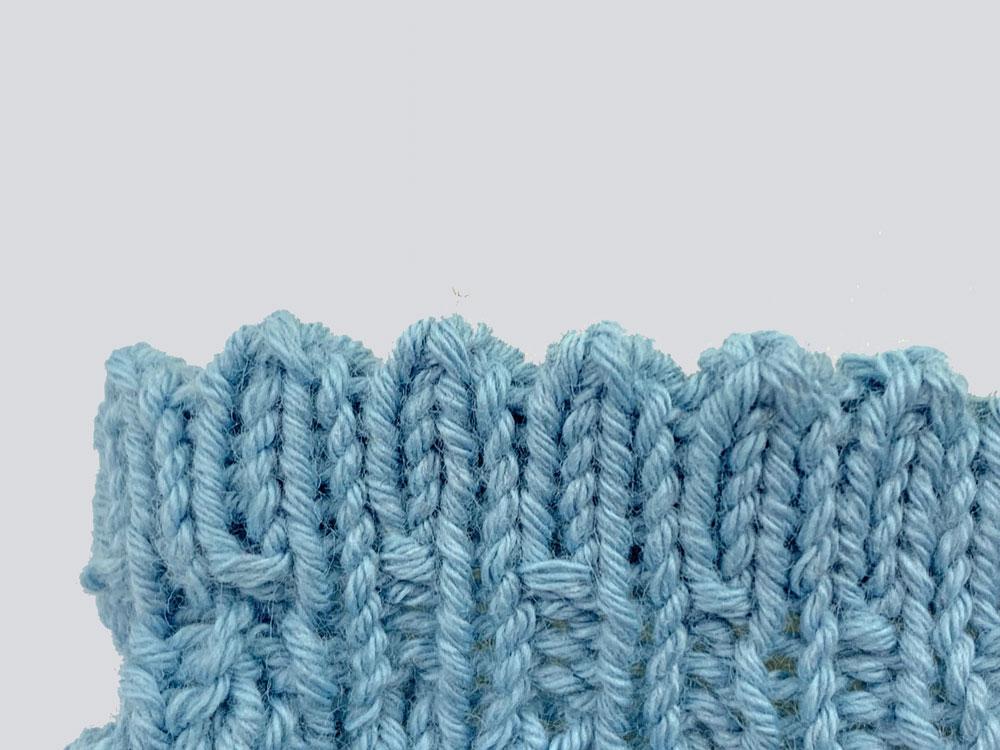 Füßlinge stricken: Der Mauszähnchenabschluss